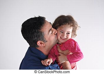 Father kisses his daughter. Parenting, fatherhood children...