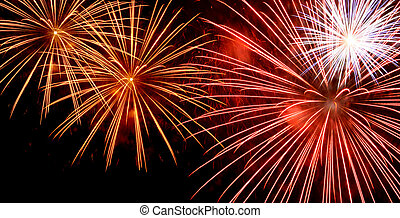 Fireworks widescreen - Red and yellow fireworks bursting on...