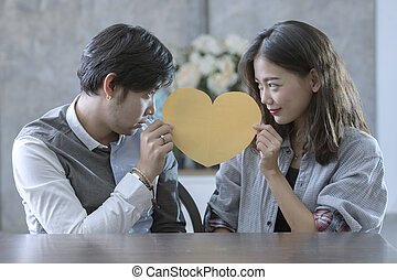 couples of asian man and woman holding heart shape paper cut...