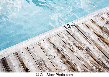 Beautiful rustic wooden pool side deck