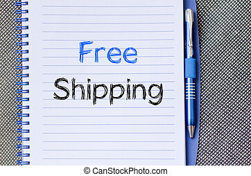 Free shipping text concept on notebook - Free shipping text...