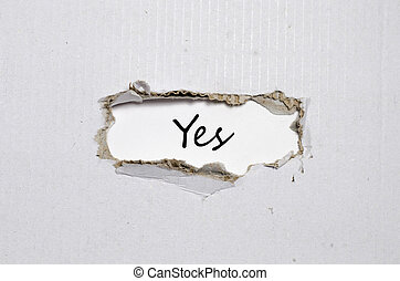 The word yes appearing behind torn paper