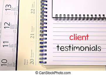 Client testimonials text concept on notebook - Client...