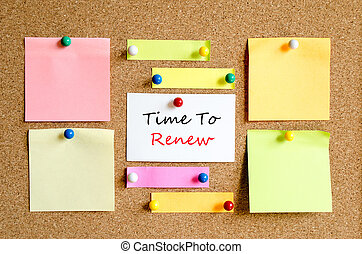 Time to renew text concept - Sticky note on cork board...