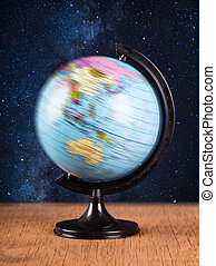 spinning globe on the background of night sky