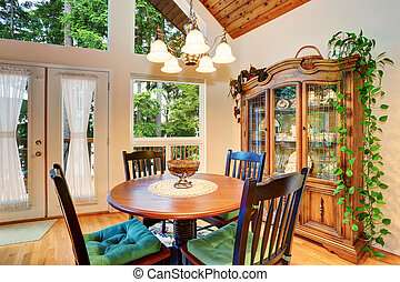 Traditional dining area with wooden table set and hardwood...