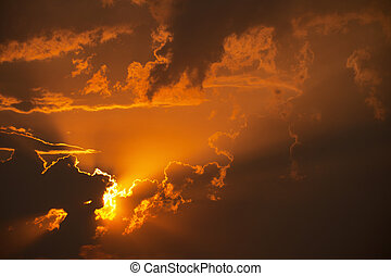 Orange sunset in clouds - Beautiful bright orange sunset in...
