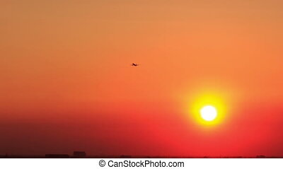 Airplane Takes off Vanishes into Space at Sunset