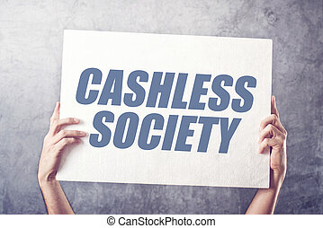 Hands holding banner with Cashless society title, concept of...