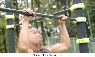 young man pull ups bars workout exercise