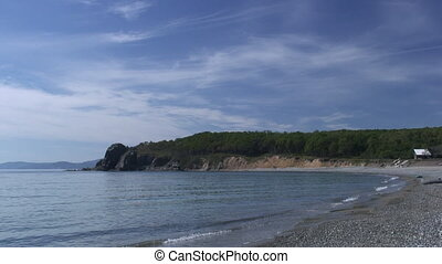 Sea waves surf on stony rocks beach. Japan Sea. Suitable for...