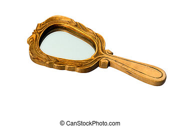 Vintage old hand mirror in wooden frame isolated on white