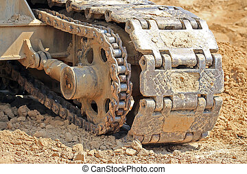 Caterpillar mover of tractor Caterpillar tractor on a clay...
