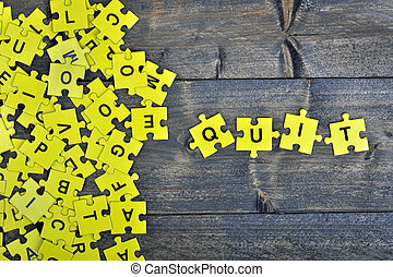 Puzzle with word Quit