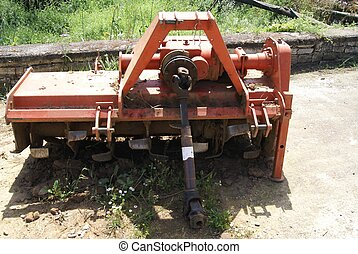 old cultivator - old farm implement used for secondary...