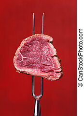 piece of steak on a meat fork