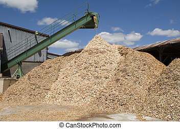 wood chips pouring from conveyor