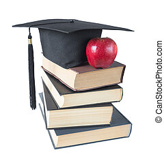 Graduate hat, books and apple - Black graduate hat, stack of...