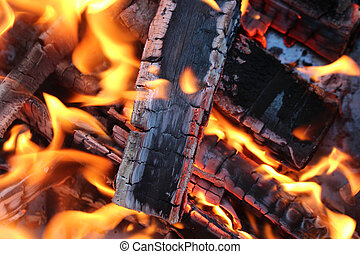 Fire and stove background - Charred wood and bright flames...