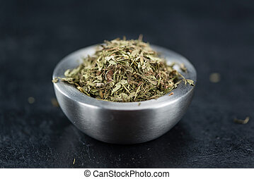 Dried Stevia leaves (on a slate slab) - Dried Stevia leaves...