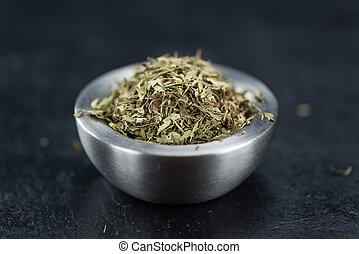 Dried Stevia leaves (on a slate slab) - Dried Stevia leaves...