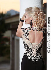 Beautiful lady back in elegant dress. Hairstyle. Red lips...
