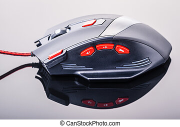 Precise gaming mouse - a sleek modern gaming mouse with red...