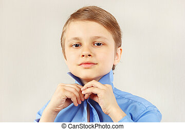 Little gentleman straighten collar of his bright shirt -...