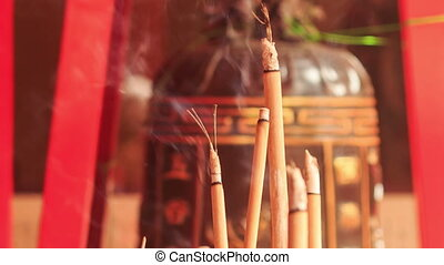 Closeup Burning Sticks in Indian Temple - closeup smoke and...
