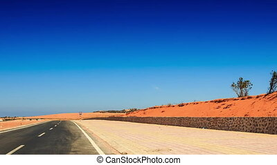 Camera Moves along Red Sand Dunes with Bushes - camera moves...
