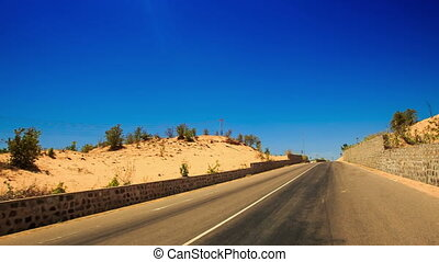 Camera Moves by Road Side Barriers Sand Dunes - camera moves...
