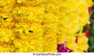 Wind Shakes White and Yellow Flower Garlands - closeup wind...