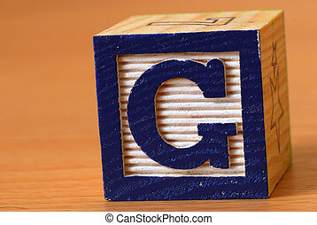 Alphabet block with a blue letter G
