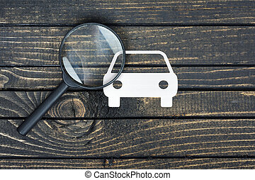 Magnifying glass and paper house on table - Magnifying glass...