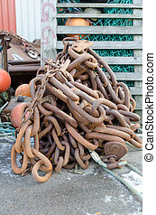 one rusty big chain for a big boat for safe