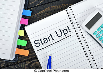Start up text on notepad and hand calculator