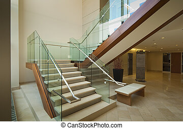 Lobby staircase - Staircase leading to 2nd floor in modern...
