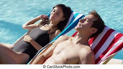 Pretty young woman relaxing with her boyfriend - Pretty...