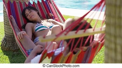 Young holiday couple relaxing in a hammock
