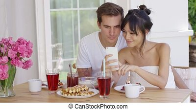Happy mixed race couple taking selfie - Happy mixed race...