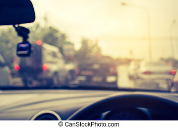 vintage tone blur image of people driving car on day time. -...