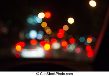 blur image of people driving car on night time . - blur...