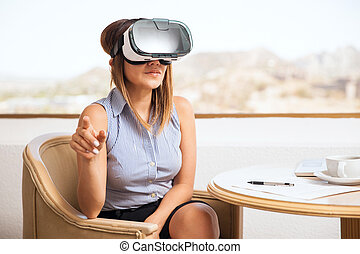 Businesswoman trying virtual reality - Young businesswoman...