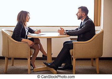 Cute female recruiter interviewing a candidate