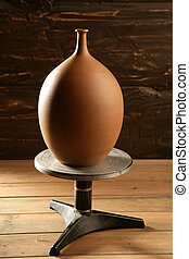 potter wheel with pottery clay vase finished