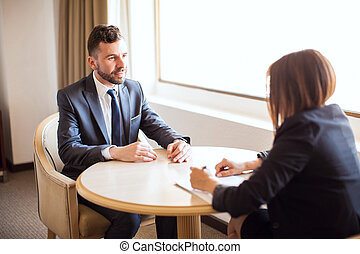 Sales executive giving a sales pitch - Portrait of a...