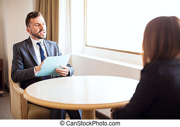 Male recruiter interviewing a job candidate