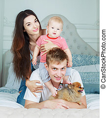 happy family at home - happy family with a baby and a dog in...
