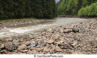 Fleeting river with stones is going on its way on the...