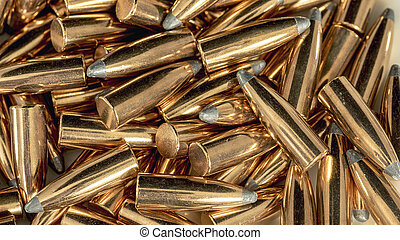 Many copper bullets ready for loading - Abstract patter on...